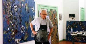 Manny Farber with his paintings