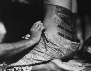 Moana being tattooed in Robert Flaherty's MOANA WITH SOUND (1926/1980). Copyright 2014 The Robert and Frances Flaherty Study Center. Playing November 13-19.