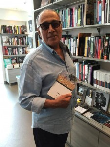 Kiarostami with AK book